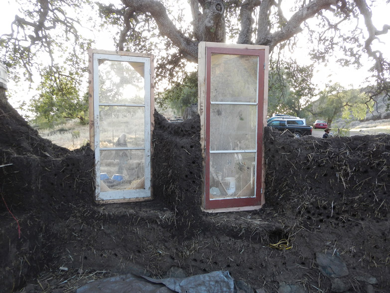 These 2 windows are facing west, where the hot afternoon sun comes from. To avoid direct sun from overheating the house, the windows are turned on an angle.
