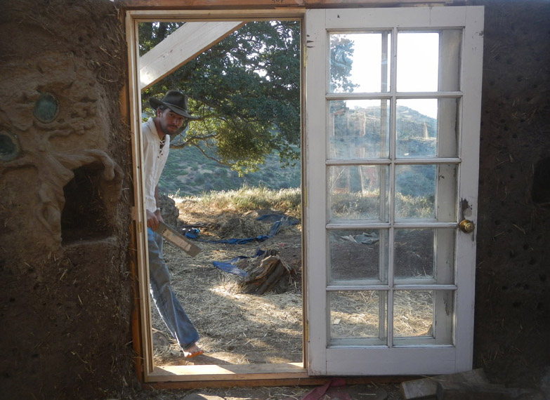 Justin (he is the future house-dweller) peeks in through the nearly finished french doors
