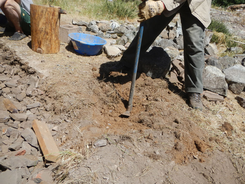 Step 1 - digging the trench; not an easy task in this super-rocky soil!